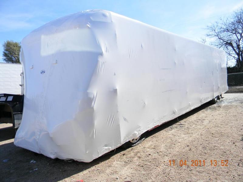 Comercial Bus wreck wrapped to mitigate damage and preserve evidence