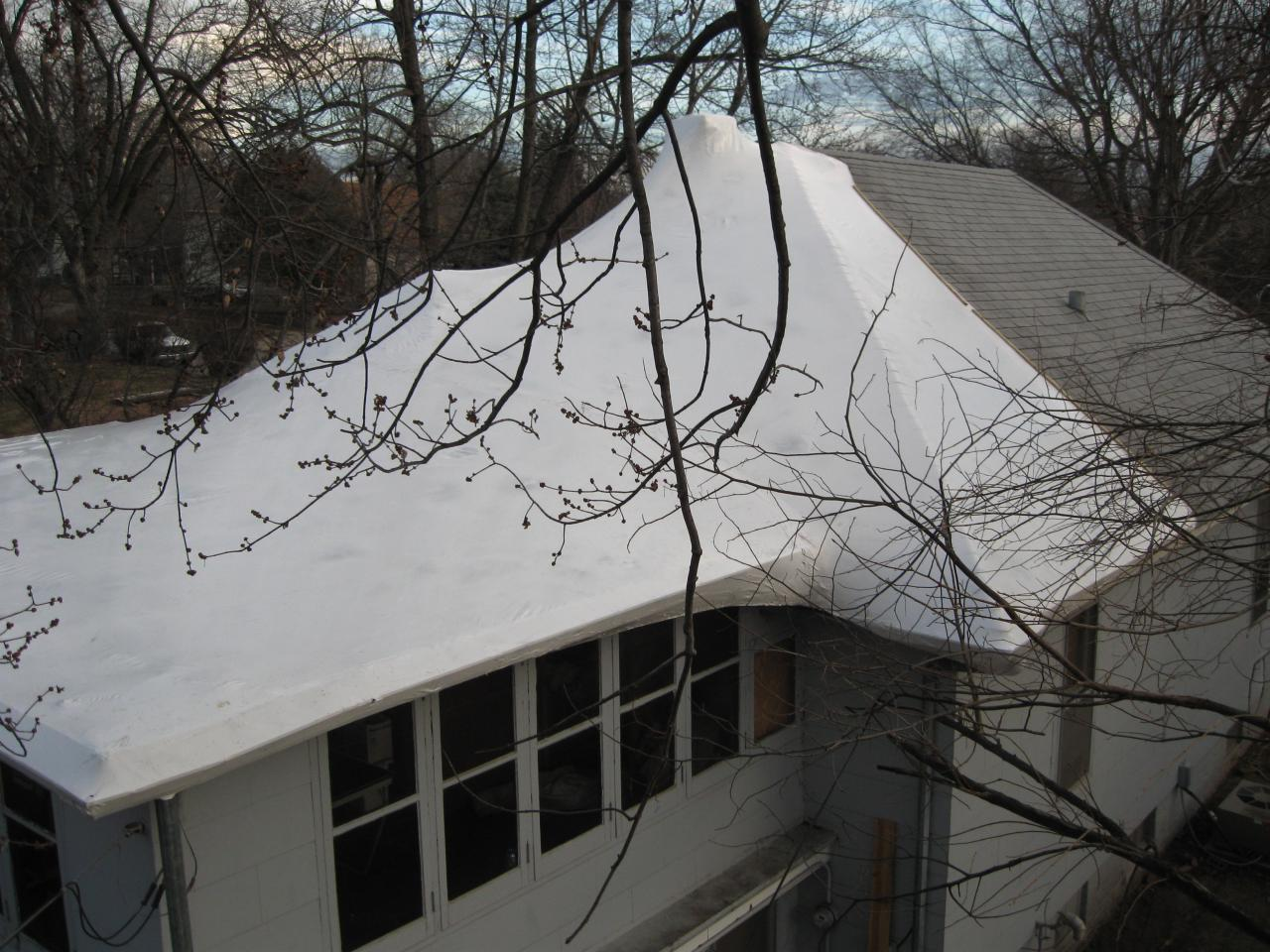 Roof shrinkwrapped due to storm damage